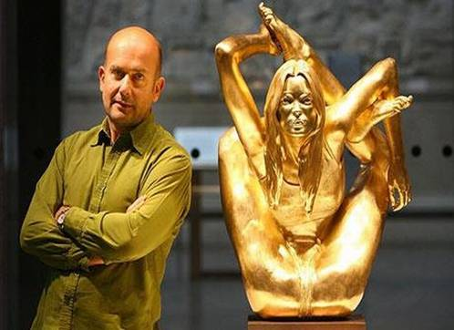 gold kate moss statue