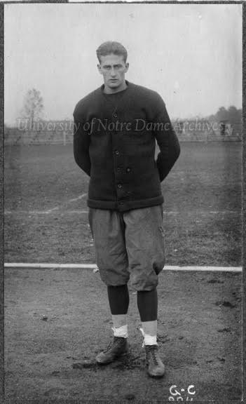 GNDS 28/24:  Football Player Rupert Mills, full-length portrait in uniform and monogram sweater, c1913.
