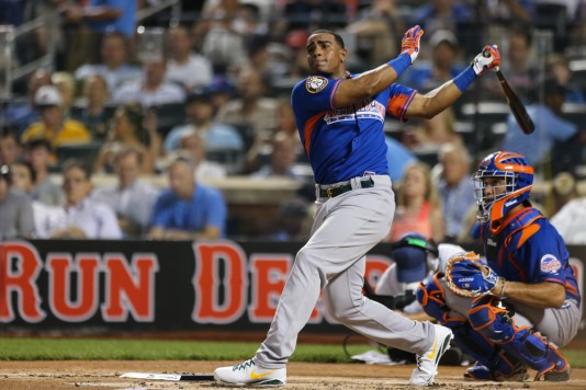 NEW YORK, NY - JULY 15: Home Run Derby participant Yoenis Céspedes #52 of the Oakland Athletics takes a swing during the 2013 Chevrolet Home Run Derby at Citi Field on Monday, July 15, 2013, in the Flushing neighborhood of the Queens borough of New York City. (Photo by Tim Clayton/MLB Photos via Getty Images)