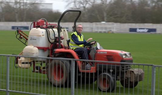 Man on riding lawnmower
